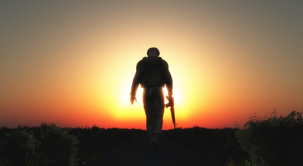 3D render of a sodier walking with his head down at sunset